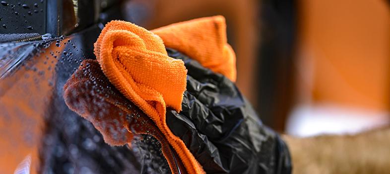 hand car wash image orange towel